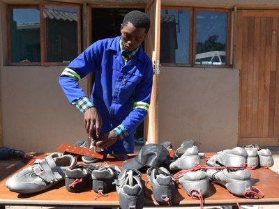 making footboards with the donated shoes